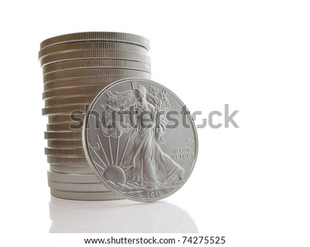 Stack of twenty uncirculated liberty silver dollars on white
