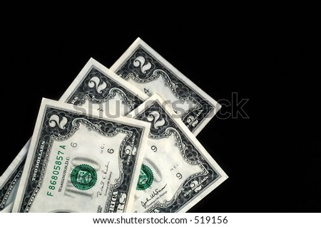 stack of two dollar bills