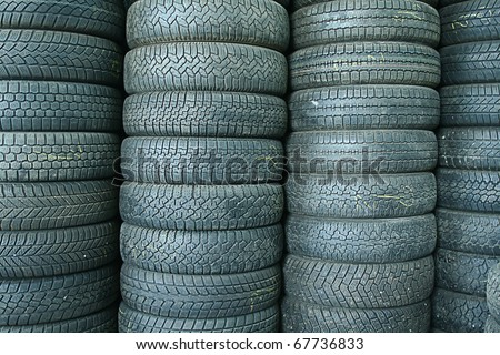 Stack of used tires in a junkyard