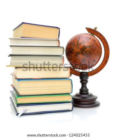 stack of various books and vintage globe isolated on a white background close-up