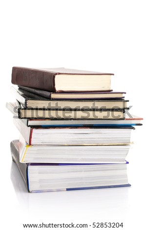 Stack of various books isolated on white background.