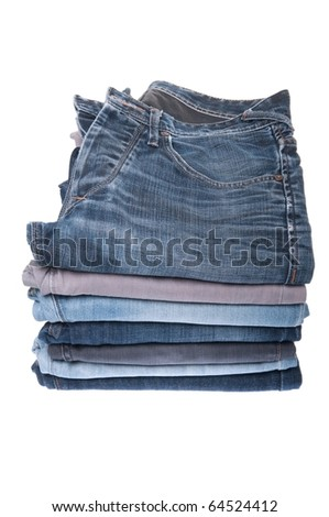 stack of various jeans isolated on white background
