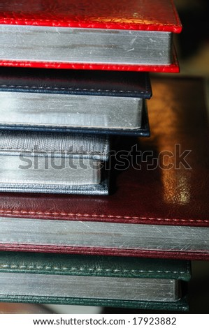 Stack of various organizers in a hard cover - stock photo