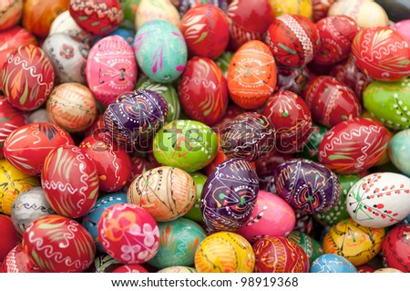 Stack of various painted wooden easter eggs