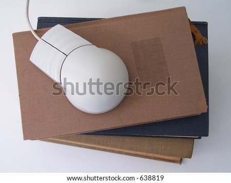 Stack of vintage books with a mouse. Conceptual for how education has changed over the years. Photo stock ©