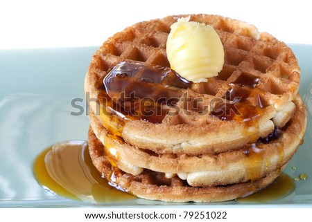 Stack of waffles with maple syrup and butter. - stock photo