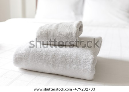 Stack of white cleaning folded tower on the bed #479232733