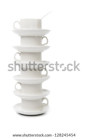 stack of white coffee cups on a white background