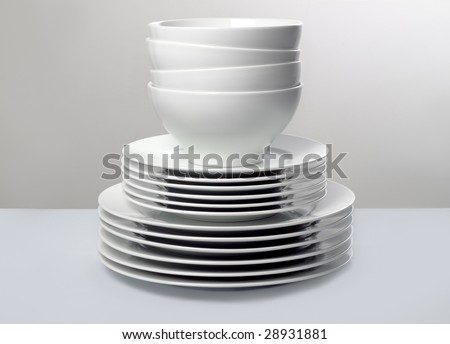 Stack of White Dishes against monochromatic background
