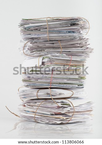 Stack of white letters and envelops on white