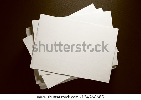 Stack of white paper cards on black