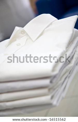 Stack of white shirts