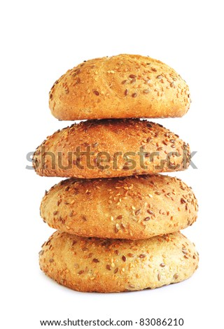 Stack of wholegrain buns with sesame, isolated