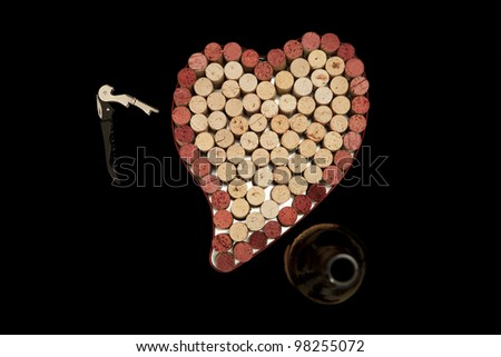 Stack of wine corks as a flat textured heart shaped background with corkscrew and bottle