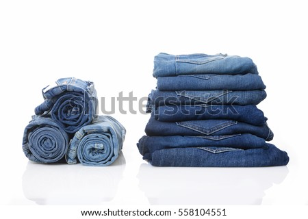 Shutterstock Stack of with roll blue jeans pants isolated on white with natural shadows