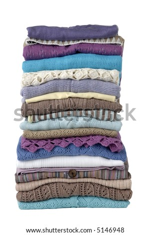 stack of womens clothing, tops, on white background with clipping path - stock photo