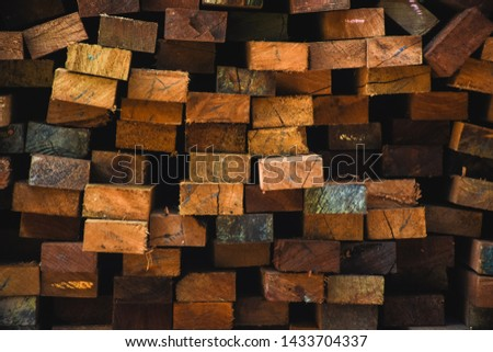 Stack of wooden bars for furniture materials background. Wood timber construction material for background and texture.