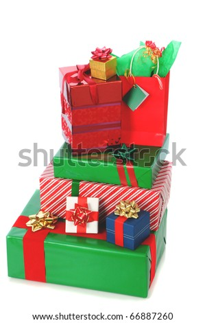 Stack of wrapped Christmas Presents isolated over white with slight shadow. Vertical Format