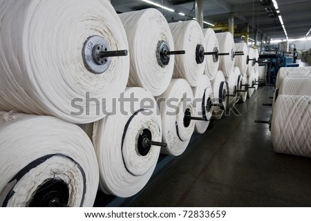 Stack of yarn spools in a textile mill.