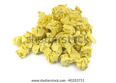 stack of yellow crumpled paper balls on white background