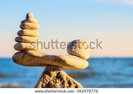 Stack of zen stones in balance at seashore