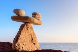 Stack of zen stones in balance on seashore