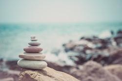 Stack of zen stones near sea. Harmony, balance.