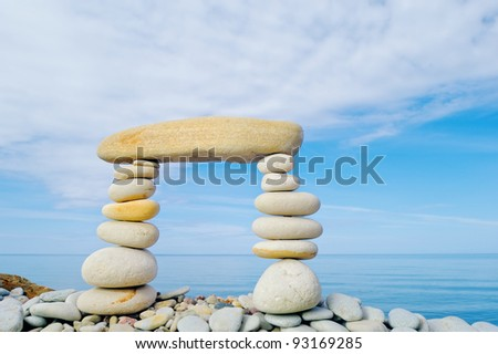 Stack of zen stones on a sky background