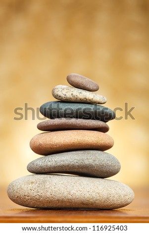 Stack of zen stones over brown background