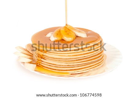 Stack pancakes with maple syrup.