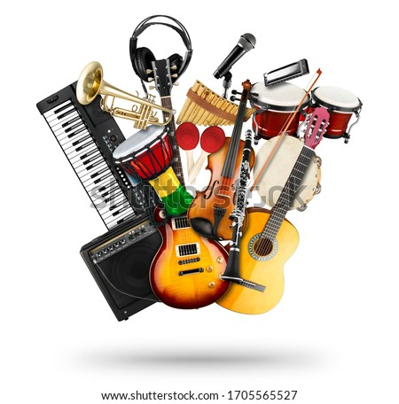 Photo of  stack pile collage of various musical instruments. Electric guitar violin piano keyboard bongo drums tamburin harmonica trumpet. Brass percussion studio music concept isolated on white background
