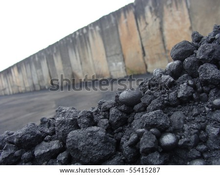 stack pile of charcoal coal on an industrial background
