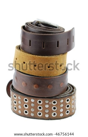 stack pile of leather belts isolated on white background