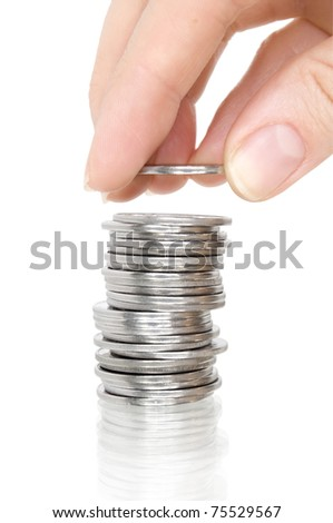 stack silver coins with reflection and hand with coin isolated on white