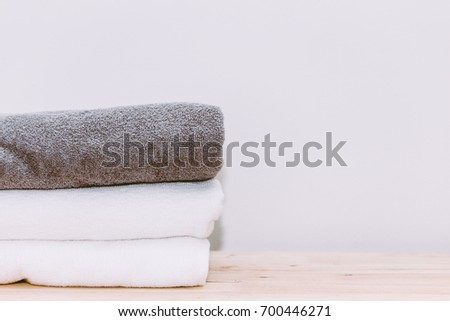 Stack towels on wooden background #700446271