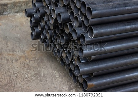 Stacked aluminum metal pipes. Heavy industry production stock photo
