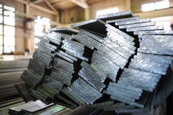 Stacked aluminum metal sheets. Heavy industry production