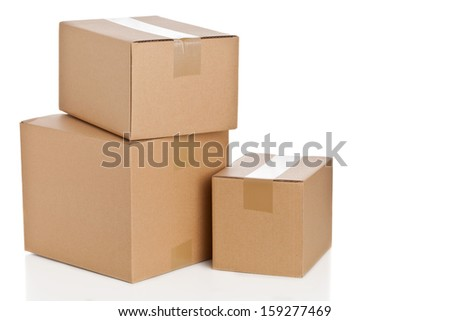 Stacked brown delivery carton boxes on white background - stock photo