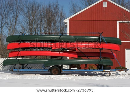 stacked canoes in winter