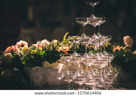 Stacked champagne pouring glass In weddings and celebrations, ideas for celebrations and festivals #1570614406