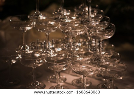 Stacked champagne pouring glass In weddings and celebrations, ideas for celebrations and festivals