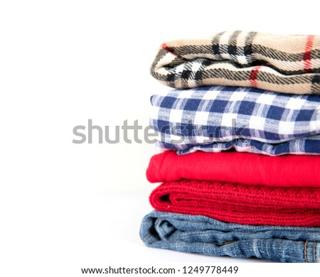 Stacked clothes on a white background