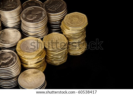 Stacked coins in columns isolated on white background
