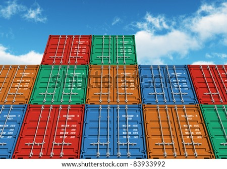 Stacked color cargo containers over the blue sky with clouds