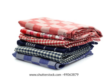 stacked colorful kitchen towels on a white background