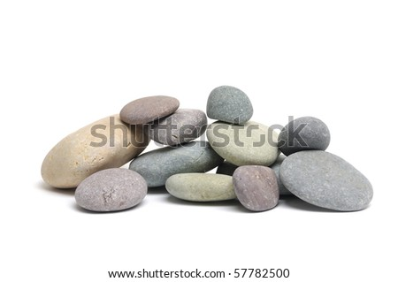 Stacked colorful sea stones on white background