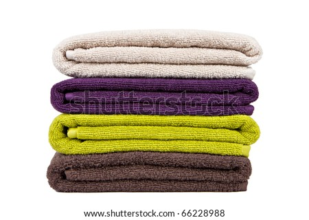 stacked colorful towels on a white backgroun