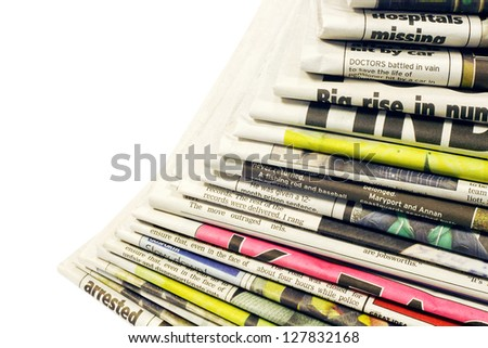 Stacked colour newspapers with copy space