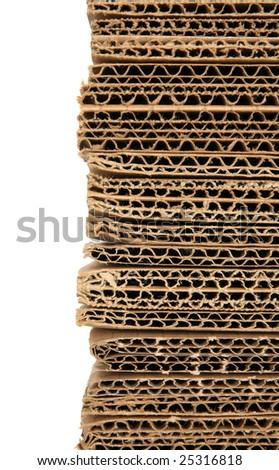 Stacked corrugated cardboard closeup, isolated on white.