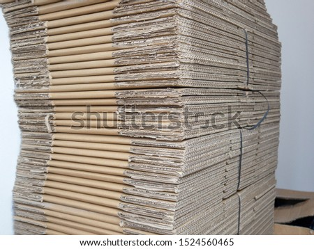 stacked corrugated transport cartons in a row